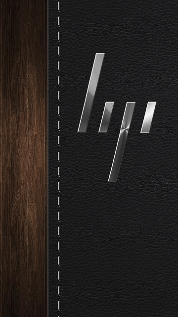 hp-light-metal-logo-leather-wood-background.jpg